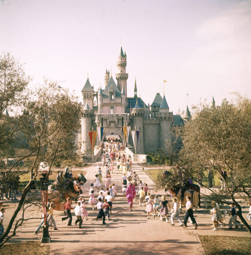 Subject: People running to Disneyland castle at Disneyland Amusement Park. Anaheim, California 1955 Photographer- Loomis Dean Time Inc Owned Merlin- 1201478